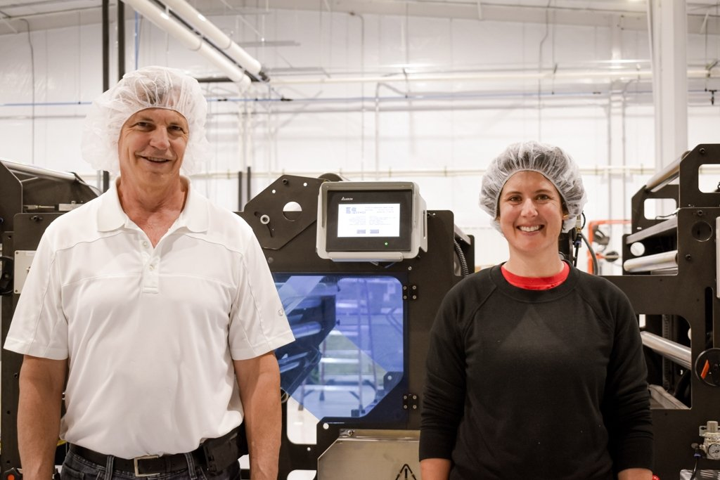 Tim Mages and Katherine O'Brien in front of machine